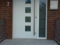 White front door after